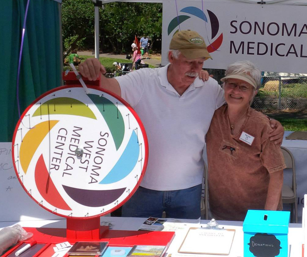 Larry Hendricks and Kaye Love at SWMF's Apple Blossom Festival booth.